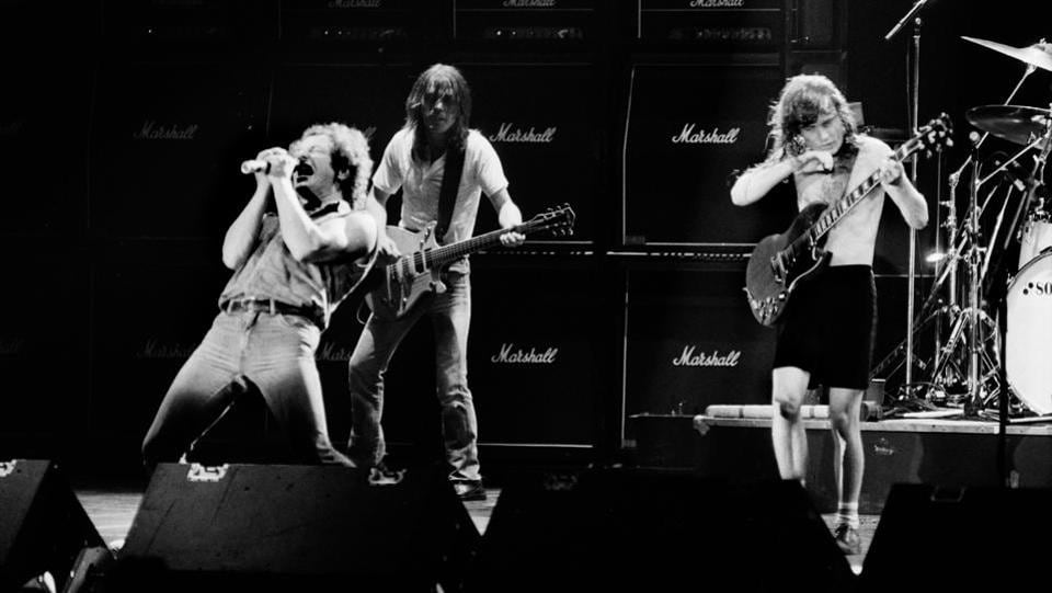 Brian Johnson performs next to guitarists Malcolm Young and Angus Young of the hard rock band AC/DC  on September 15, 1984 in Paris. Best known for their hit song 'Highway to Hell,' AC/DC produced 17 studio albums, selling more than 200 million records. (Jean-Claude Coutausse / AFP)