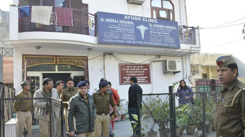 Police at Dr Neeraj Agarwal's clinic-cum-residence in Sector 2C, Vasundhara, on Tuesday.