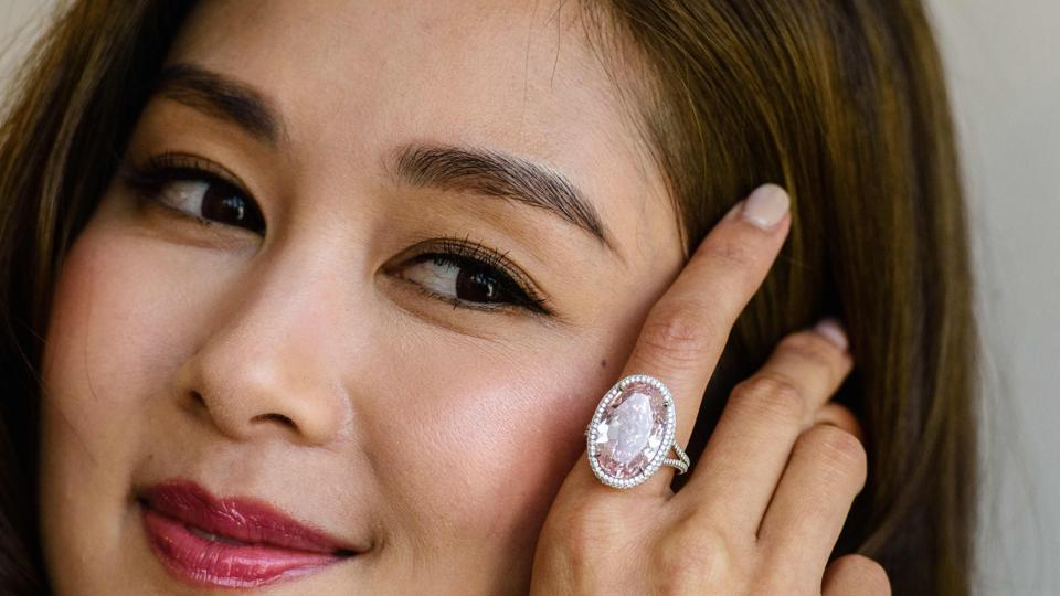 "The 14.93-carat pink gemstone named the ""Pink Promise"" was sold on Tuesday for an eye-watering $32.16 million at auction in Hong Kong."