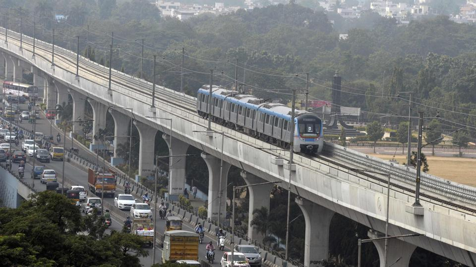 A metro train runs on an elevated railway line during a trial run undertaken ahead of the opening of the Hyderabad Metro Rail (HMR) project in Hyderabad. In its first phase with 24 stations, the metro will cover a 30 km stretch and is expected to carry 17 lakh passengers everyday. (Noah Seelam / AFP)