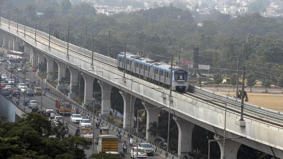 A metro train runs on an elevated railway line during a trial run in Hyderabad.