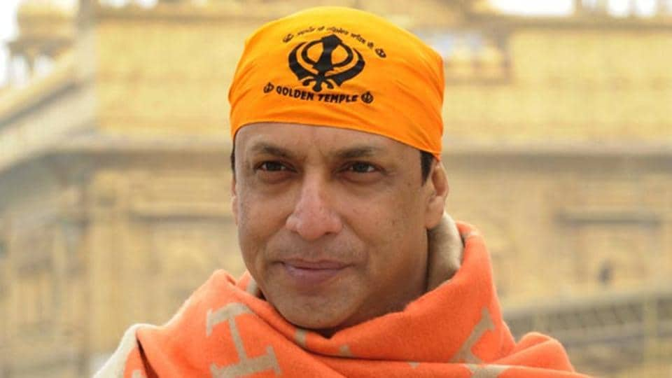 Filmmaker Madhur Bhandarkar poses for a photograph during a visit to the Golden temple in Amritsar on January 10. (AFP Photo)