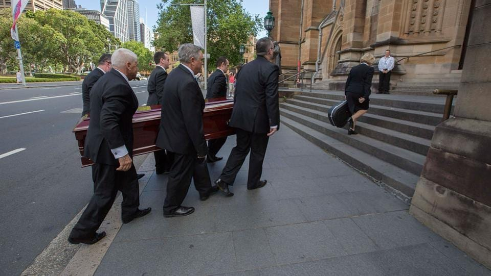 "The casket is carried into the church for the funeral service of Malcolm Young at St Mary's Cathedral in Sydney. Young died on November 18, aged 64, after years of ill health. According to the Australian Broadcasting Corporation, those at the service were given guitar picks with their programs and Malcolm's Gretsch guitar, which he called ""the beast"", rested on top of his casket throughout. (Michele Mossop / Getty Images)"