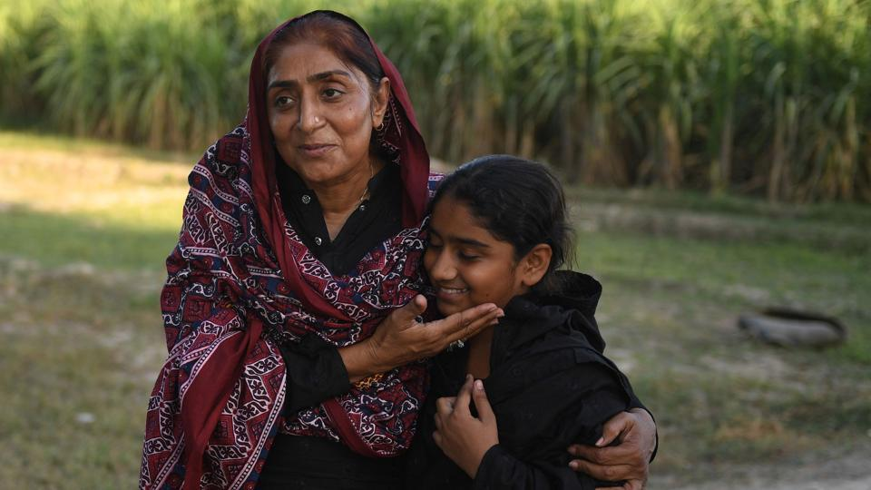 "Mukhtiar Naz (L), known as Waderi Nazo Dharejo with her daughter Urooj in Qazi Ahmed, Pakistan. A fierce gunfight earned her the moniker of 'Pakistan's toughest woman', and became the subject of the film 'My Pure Land' which has been entered in next year's Academy Awards, vying for glory alongside heavy-hitters such as Angelina Jolie's ""First They Killed My Father"" and Joachim Trier's ""Thelma"". (Asif Hassan / AFP)"
