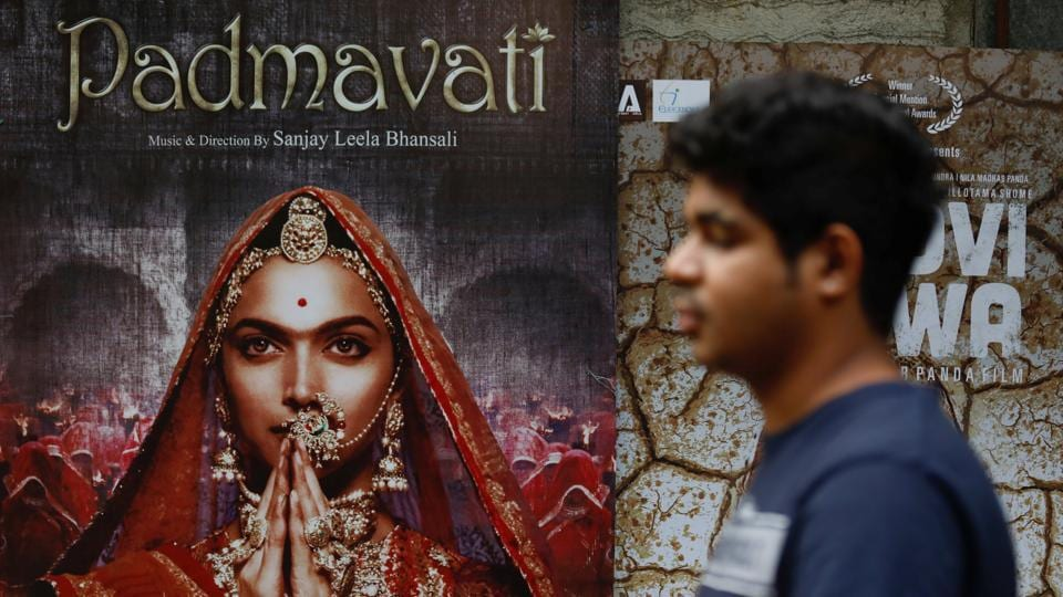 A man walks past a poster of the upcoming movie 'Padmavati' outside a theatre in Mumbai.(REUTERS)