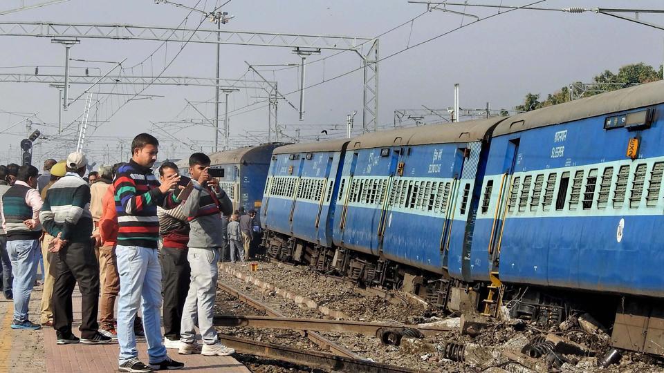 Bystanders take photos of derailed coaches of Vasco Da Gama-Patna express train near Manikpur railway station in Manikpur Uttar Pradesh on Friday.
