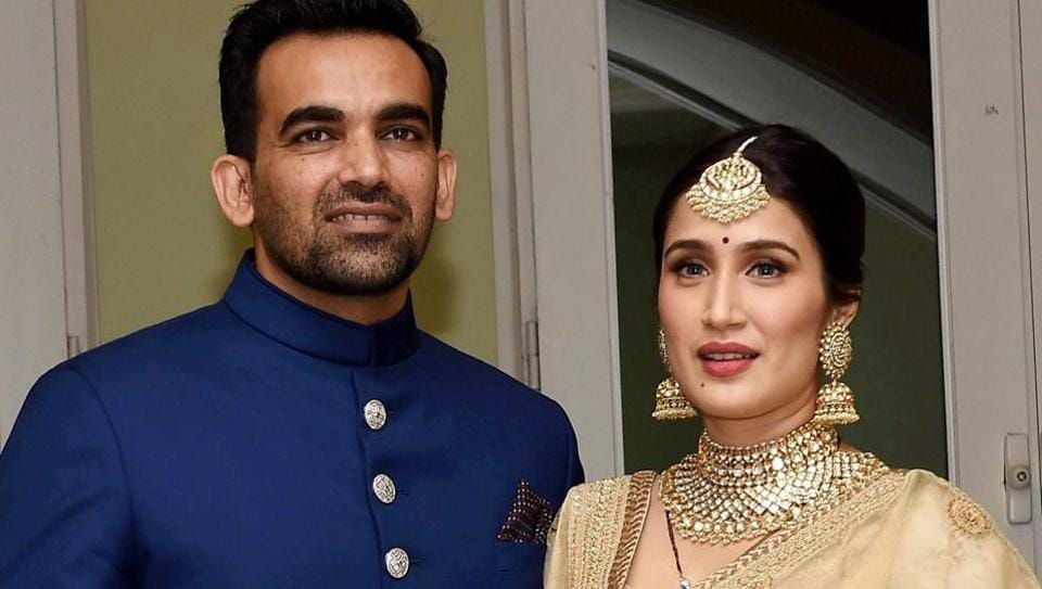 Zaheer Khan with his wife Sagarika Ghatge pose for photographers before his reception party in Mumbai on Monday.