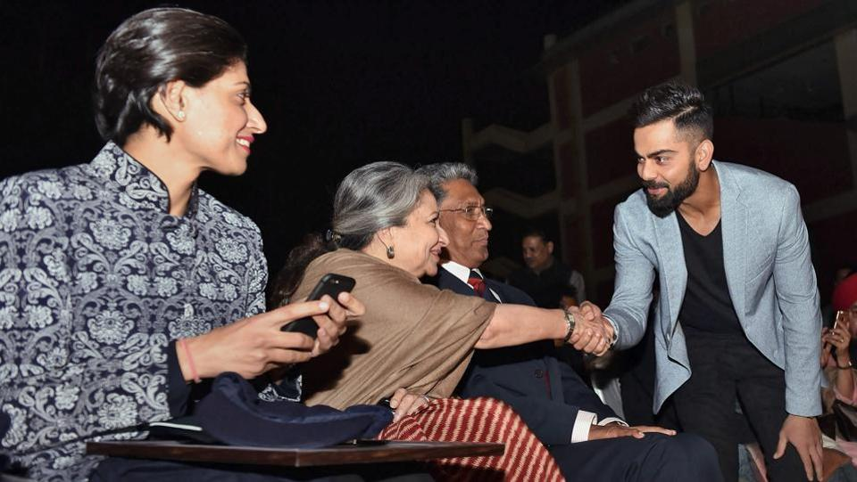 Indian cricket captain Kohli greets Sharmila Tagore as Anjum Chopra looks on during the DDCA's 1st Annual Conclave. (PTI)