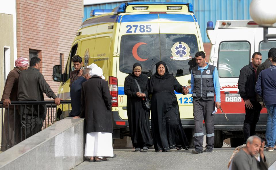Relatives of the victims of the bomb and gun assault on the North Sinai mosque wait outside the Suez Canal University hospital in the eastern port city of Ismailia on November 25, 2017, where the injured were taken to receive treatment.