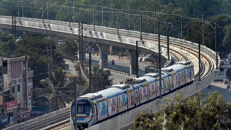 A metro train runs on its tracks after the inauguration of Hyderabad Metro Rail project in Hyderabad.