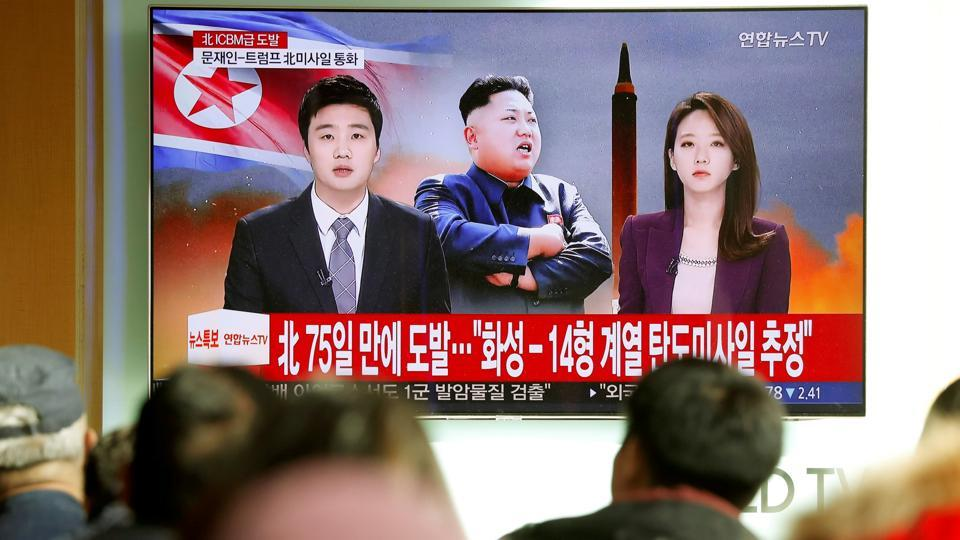 People in Seoul watch a TV broadcasting a news report on North Korea firing what an intercontinental ballistic missile on Wednesday that landed close to Japan.