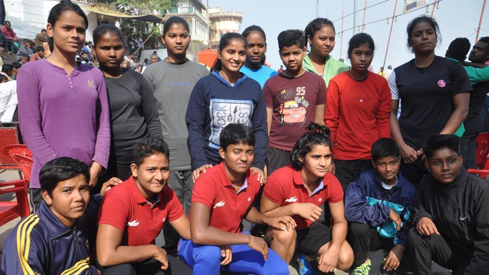 "The all women's wrestlers group poses for a picture at the event. The winners will take home cash rewards. ""The amount will be disclosed on the concluding day (Thursday),"" Kallu Pahalwan said. (Rajesh Kumar / HT Photo)"