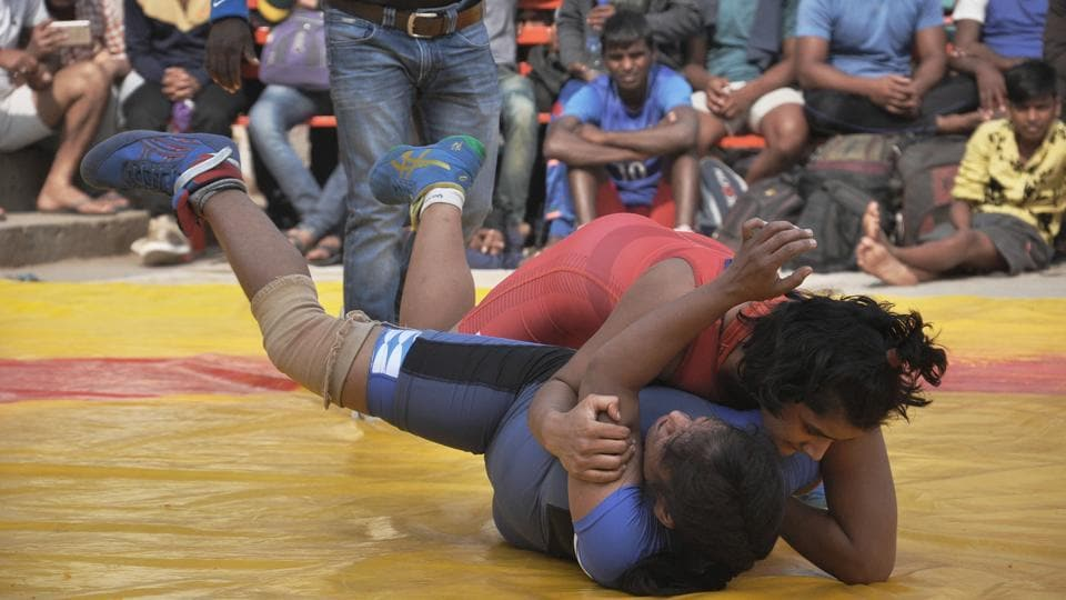 Freedom Yadav slams her opponent Bhavana to the mat during their match. A total of 24 young women are participating in two weight classes of 48kg and 75kg at the event. (Rajesh Kumar / HT Photo)