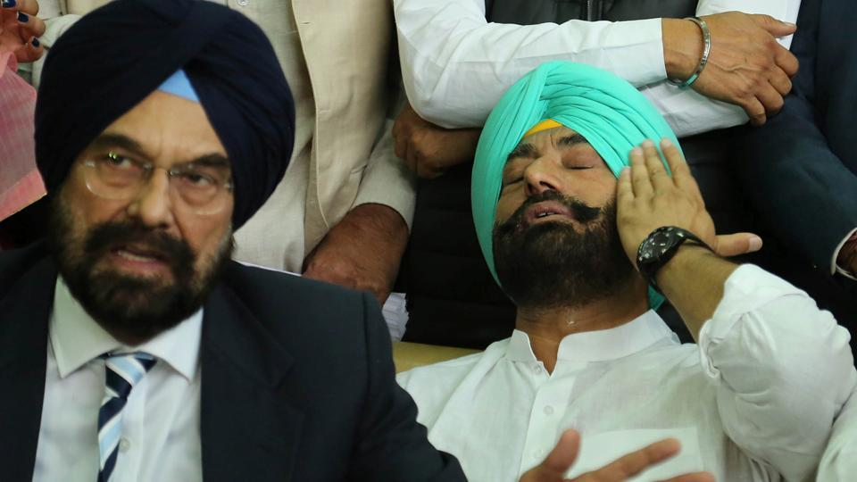 AAPMLA Kanwar Sandhu makes a point as leader of opposition Sukhpal Khaira wipes his tears after an emotional outburst at a press conference in Chandigarh on Wednesday.