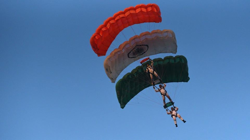 Paratroopers with their Tricolour parachutes during the PT & Equestrian Display of the 133rd NDA course at The National Defence Academy (NDA) in Pune on Wednesday. (Pratham Gokhale/HT Photo)