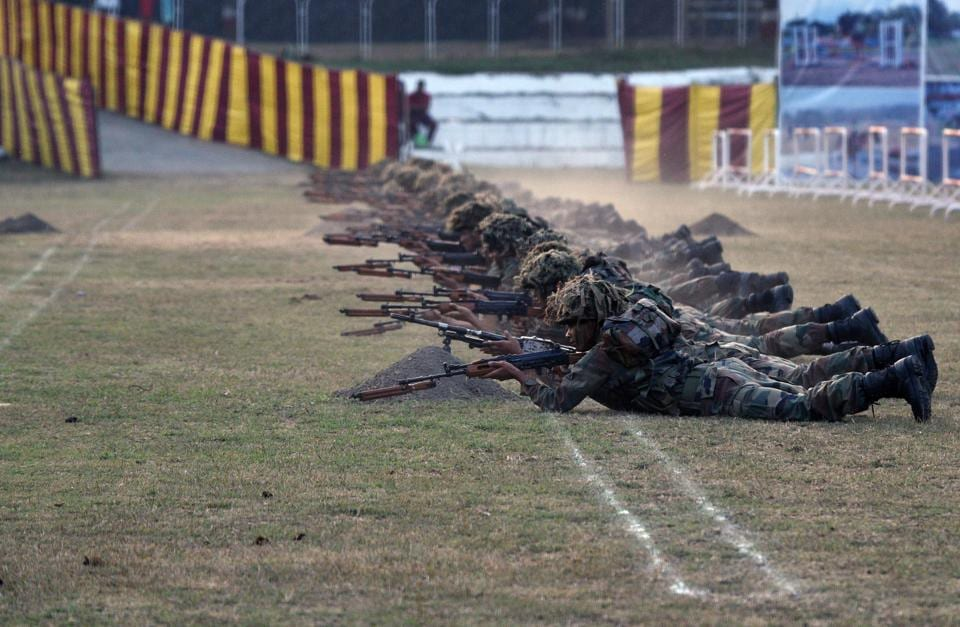 Cadets enact a combat scene as they prepare for the bayonet charge (dhava) during the PT & Equestrian Display of the 133rd NDA course at The National Defence Academy (NDA) in Pune on Wednesday. (Pratham Gokhale/HT Photo)