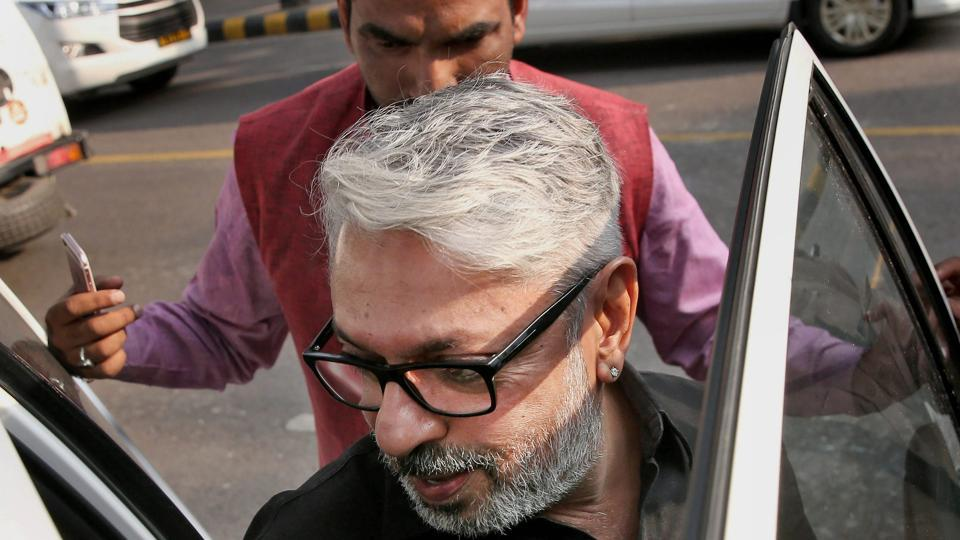 Sanjay Leela Bhansali arrives to meet a parliamentary panel in New Delhi on Thursday to discuss the controversy surrounding his upcoming movie Padmavati.