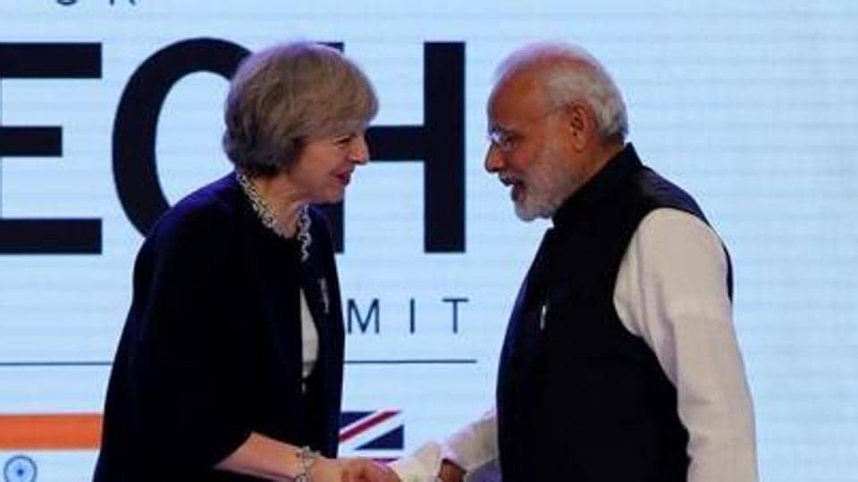 Britain's Prime Minister Theresa May shakes hands with Prime Minister Narendra Modi during the India-UK Tech Summit in New Delhi, November 7, 2016. REUTERS/Adnan Abidi/Files