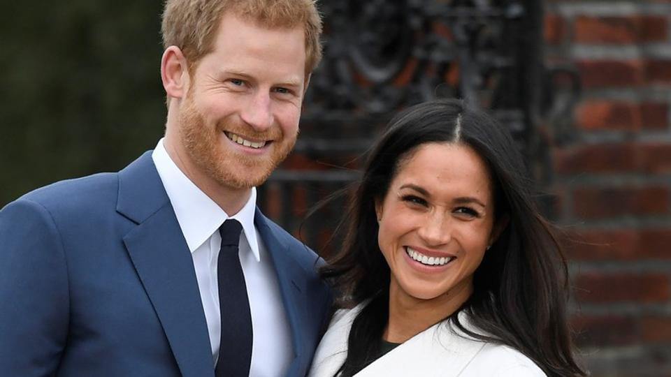 Britain's Prince Harry poses with Meghan Markle in the Sunken Garden of Kensington Palace.