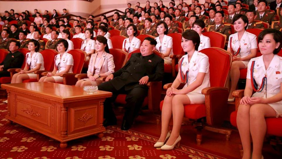 North Korean leader Kim Jong Un (3rd R) and wife Ri Sol Ju (4th L) enjoy an art performance given by the Chongbong Band to mark the 70th anniversary of the founding of the Workers' Party of Korea (WPK) in this undated photo released by North Korea's Korean Central News Agency (KCNA) in Pyongyang on October 19, 2015.