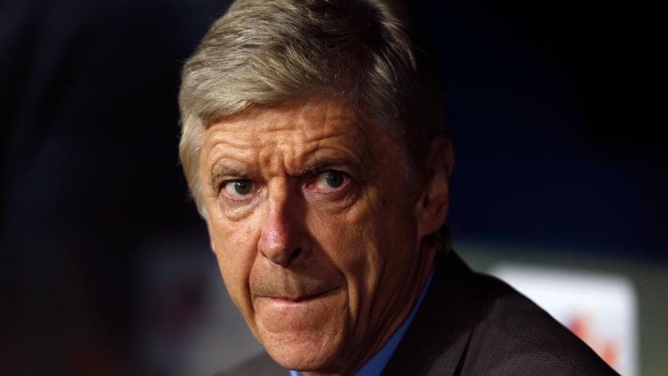 Arsenal manager Arsene Wenger sits on the bench prior to the UEFA Europa League football match against FC Cologne.