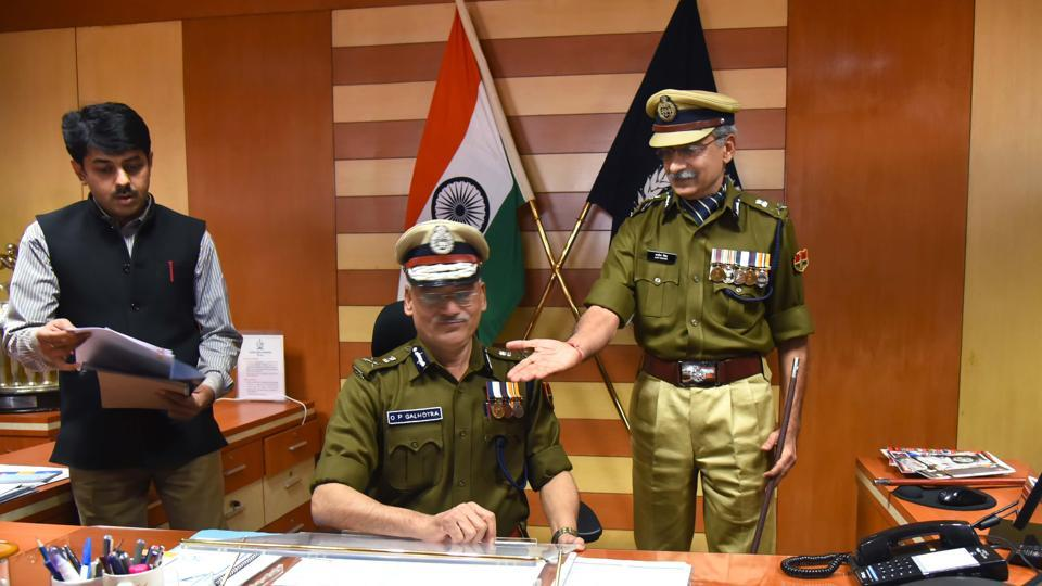 Outgoing DGP Ajit Singh ushers in new DGP OP Galhotra into his office on Thursday.