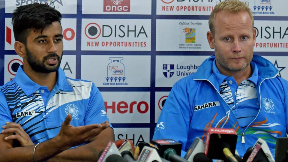 Indian hockey team coach Sjoerd Marijne(R) attends a press conference ahead of their Hockey World League Final opener.