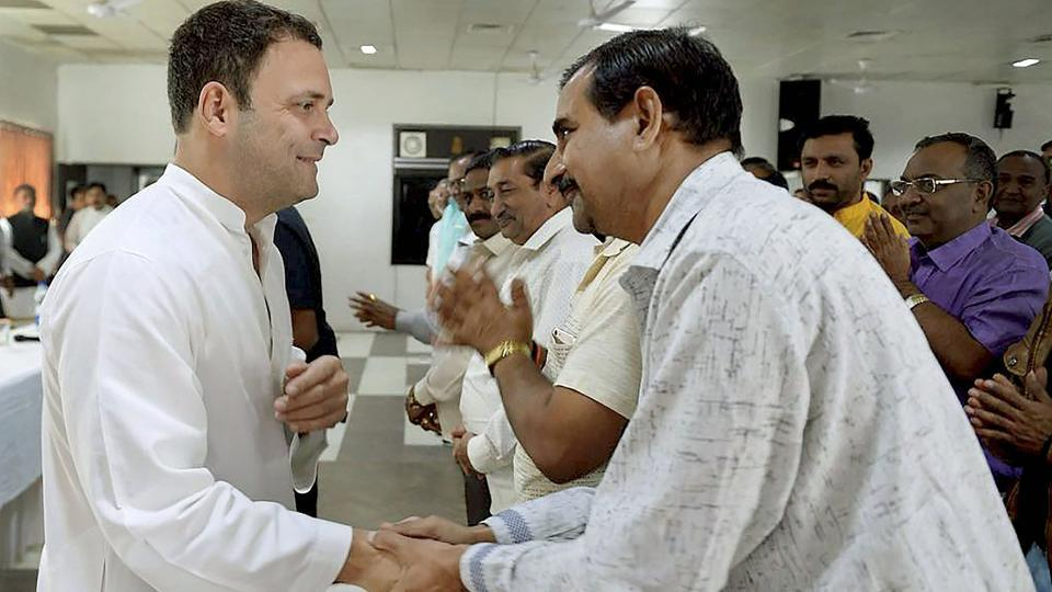 Congress vice-president Rahul Gandhi meets a delegation of traders' representatives in Amreli, Gujarat, on Thursday.