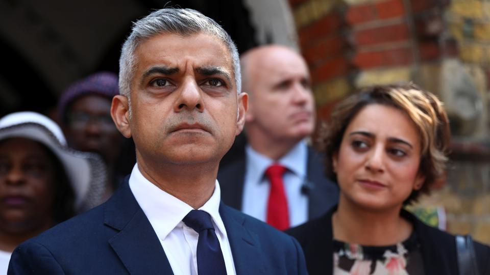 Mayor of London Sadiq Khan speaks after meeting victims and volunteers of the Grenfell apartment tower fire at a church in north Kensington, London, Britain, June 18, 2017.