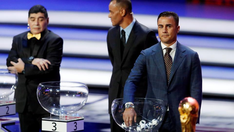Fabio Cannavaro prepares to pull a team out during the draw as Cafu and Diego Maradona look on. (REUTERS)