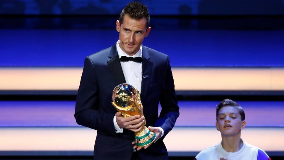 Miroslav Klose with the FIFA World Cup trophy during the draw. (REUTERS)