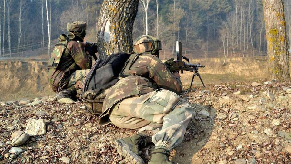 Army personnel in position surround a house where militants were hiding during an on going encounter in Kupwara District of Kashmir .