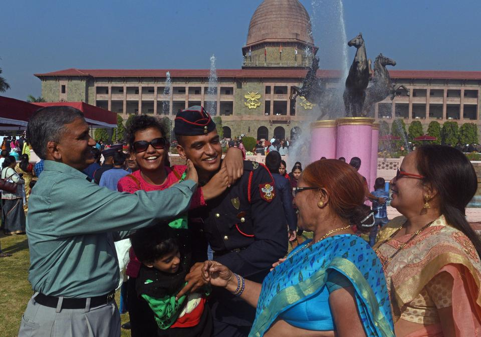 Cadets share a light moment with family members after the Passing Out Parade of the 133rd course of the National Defence Academy (NDA) in Pune on Thursday. (Pratham Gokhale/HT Photo)