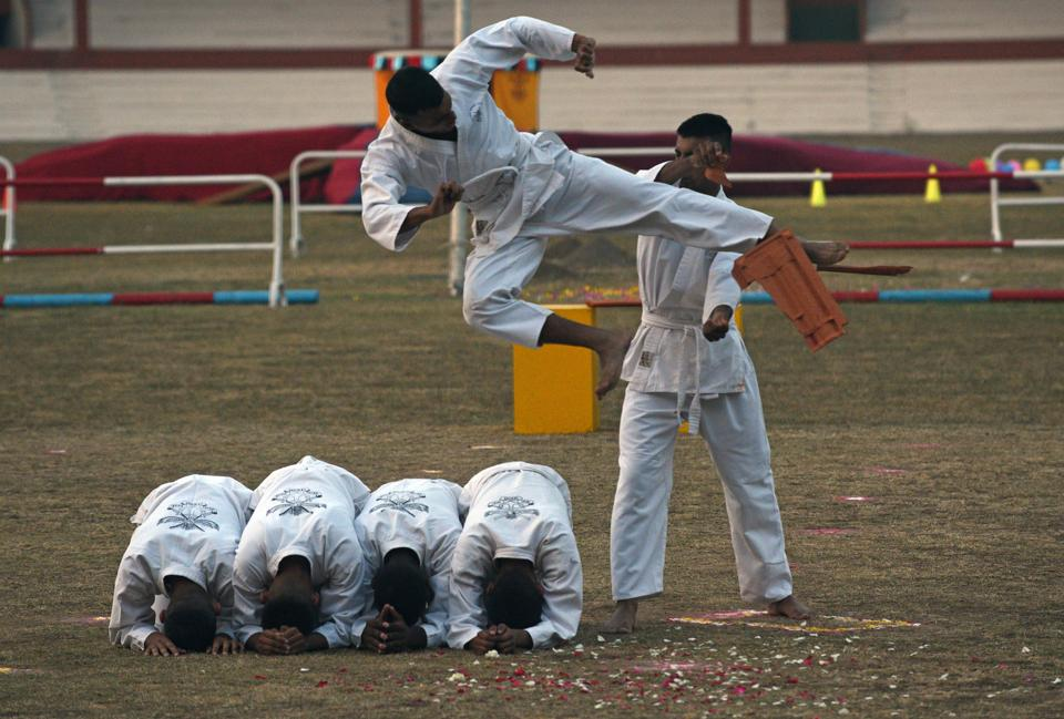 Cadets display their Karate skills during the PT and  Equestrian Display of the 133rd NDA course at The National Defence Academy (NDA) in Pune on Wednesday. (Pratham Gokhale/HT Photo)
