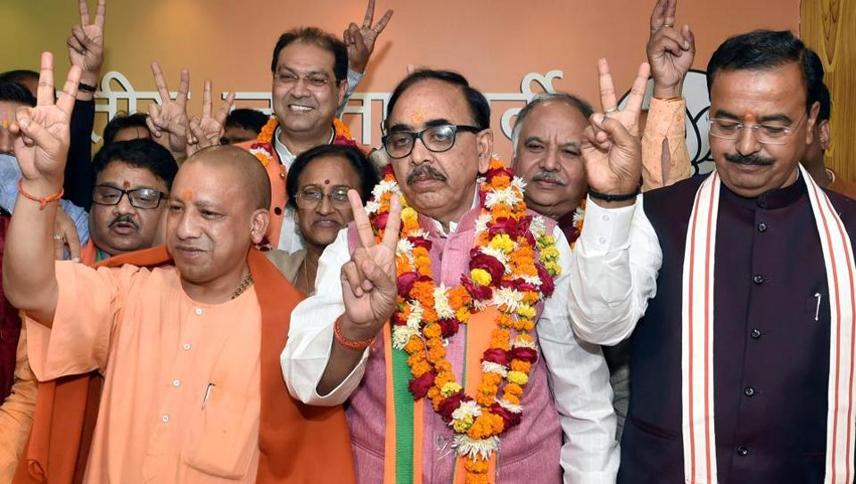 Uttar Pradesh chief minister Yogi Adityanath, deputy CM Keshav Prasad Maurya and BJP state president Mahendra Nath Pandey celebrate the victory of the party in the state civic body elections at the party office in Lucknow on December 1.