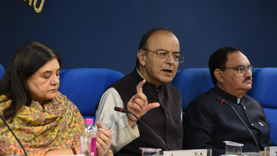 Finance and Corporate Affairs Minister Arun Jaitley (center) brief media after cabinet meeting along with Women and Child Development Minister Maneka Gandhi (left), and Health Minister J P Nadda in New Delhi, India, on Friday, December 1, 2017.