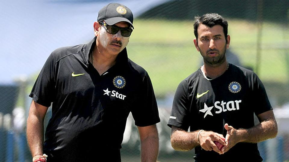 Indian cricket team coach Ravi Shastri (L) feels Cheteshwar Pujara (R) should be in the top bracket of central contracts.