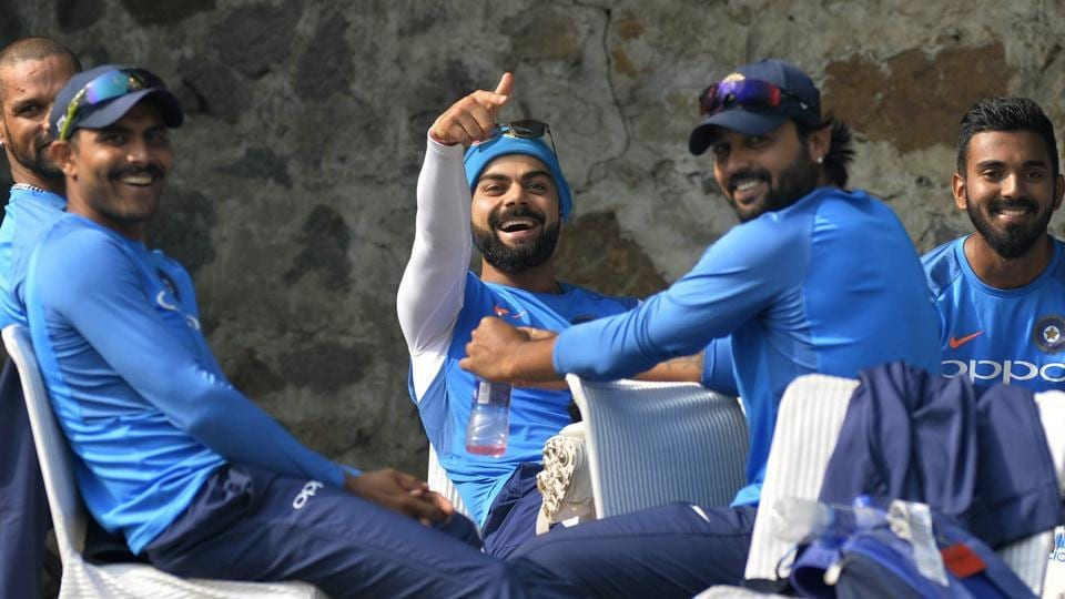 IVirat Kohli, Indian cricket team skipper shares a light moment during a practice session ahead of the third Test match between India and Sri Lanka in New Delhi. (AFP)