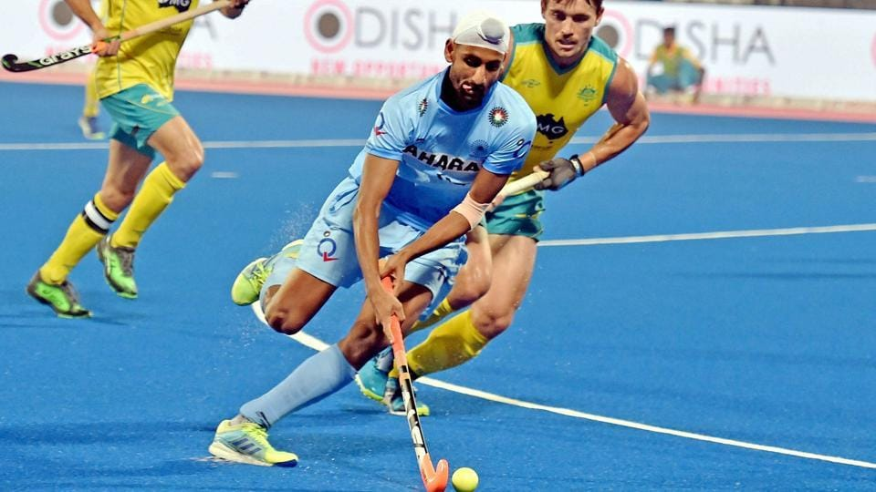 Australian defenders chase Mandeep Singh of Indian hockey team, who scored in their Pool B opening matchof the FIH Men's Hockey World League Final in Bhubaneswar on Friday.
