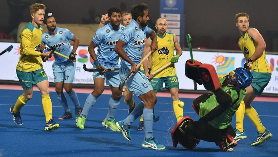 India and Australia players vie for the ball  during their Hockey World League Final match in Bhubaneswar.