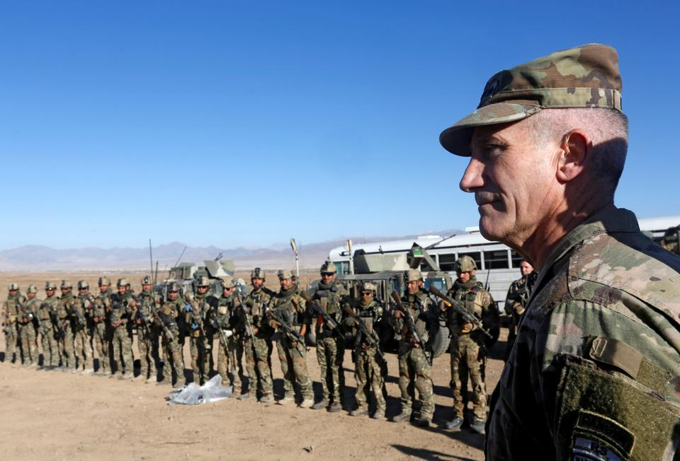 US Army General John Nicholson, commander of Resolute Support forces and US forces in Afghanistan, speaks to Afghan police special forces personnel after they took part in a military exercise in Logar province in Afghanistan on November 30, 2017.