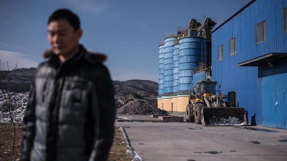 "The most recent resolution --passed in September after Pyongyang detonated its most powerful nuclear device to date-- forbade trade in textiles and imposed limits on oil supplies. ""There is some impact,"" said Han Yue, deputy manager of the Chinese-owned Rason Songsin Building Materials cement plant. ""Many things can't be imported from China anymore because of the UN sanctions, in terms of the transfer of funds from both sides you could say it has been cut off."" (Ed Jones / AFP)"