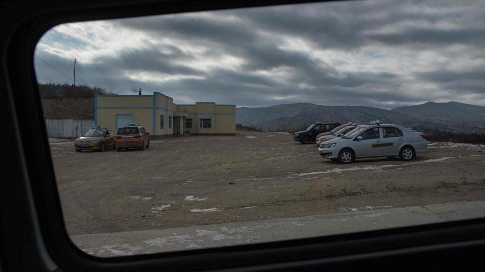 At the northeastern tip of North Korea, where the hermit kingdom meets its giant neighbours China and Russia, UN sanctions over its weapons programmes are having an impact. And with the North possibly facing further sanctions following its latest ICBM test, things are unlikely to get easier for traders involved in the remote region's Rason Special Economic Zone (SEZ). Taxis wait near the North Korean border with China to collect business people. (Ed Jones / AFP)