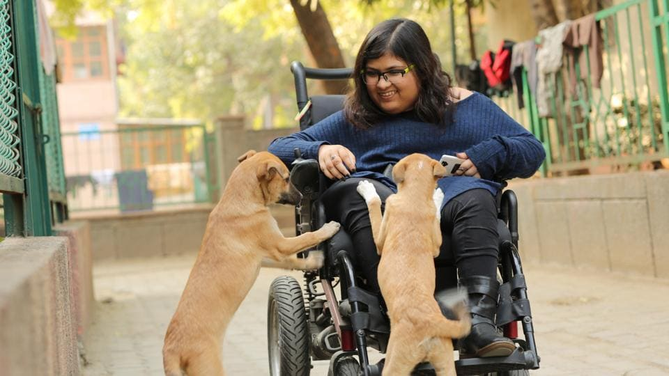 Tanya Kaushik plays with dogs near her house in Delhi.