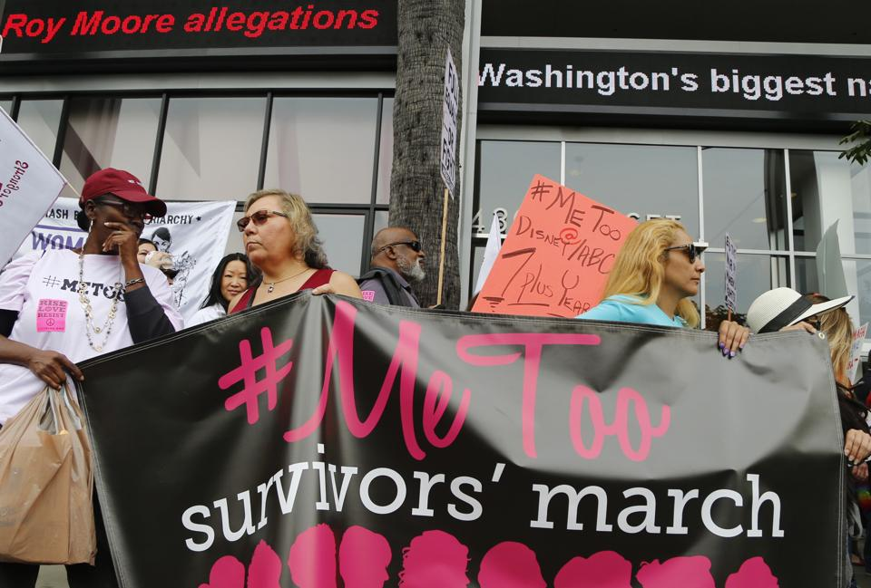 In this file photo, participants rally outside CNN's Hollywood studios on Sunset Boulevard to take a stand against sexual assault and harassment for the #MeToo March in the Hollywood district of Los Angeles. A spate of recent public revelations, including the spontaneous #metoo discussions on social media, is emboldening many victims of sexual harassment to speak up, but many still remain silent.