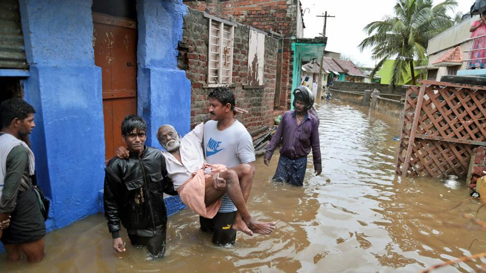 Heavy rains and gushing winds hammered the southern coast of Tamil Nadu and Kerala on Thursday as a deep depression in the Bay of Bengal turned into a cyclone named Ockhi, leaving a trail of destruction. An elderly person is carried to safety from a flooded locality following a storm at Nagercoil in Kanyakumari district.  (PTI)