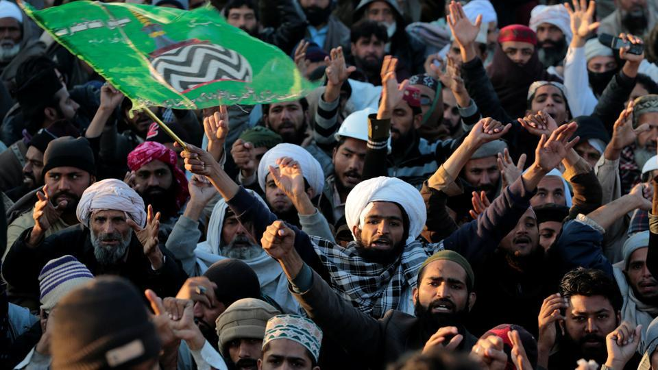 Supporters of the Tehrik-e-Labaik Pakistan Islamist political party shout slogans as their leader speaks with the media at their protest site at Faizabad junction in Islamabad, Pakistan November 27, 2017.