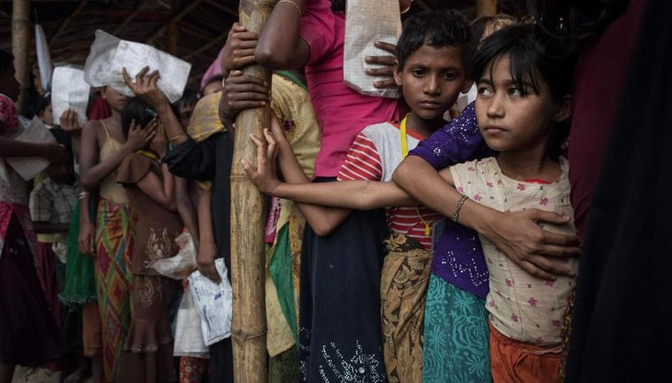 Rohingya migrants wait at a relief centre at the Balukhali refugee camp at Cox's Bazar on November 30.