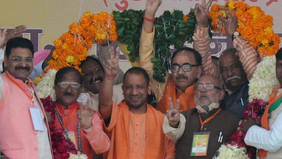 UP chief minister Yogi Adityanath being garlanded at a public meeting in support of BJP candidates for municipal corporation elections, in Moradabad on November 26, 2017.