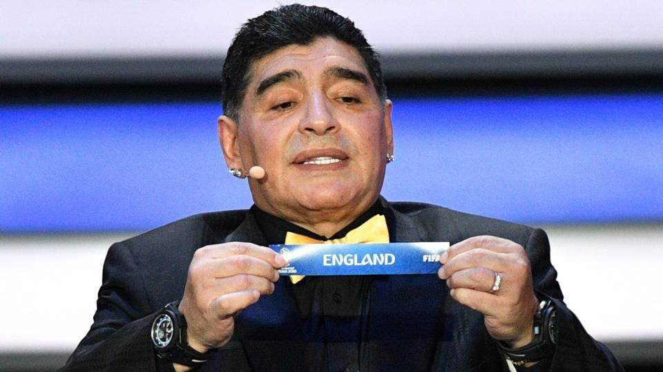 Former Argentina legend Diego Maradona displays the slip of England during the Final Draw for the 2018 FIFA World Cup at the State Kremlin Palace in Moscow on Friday.